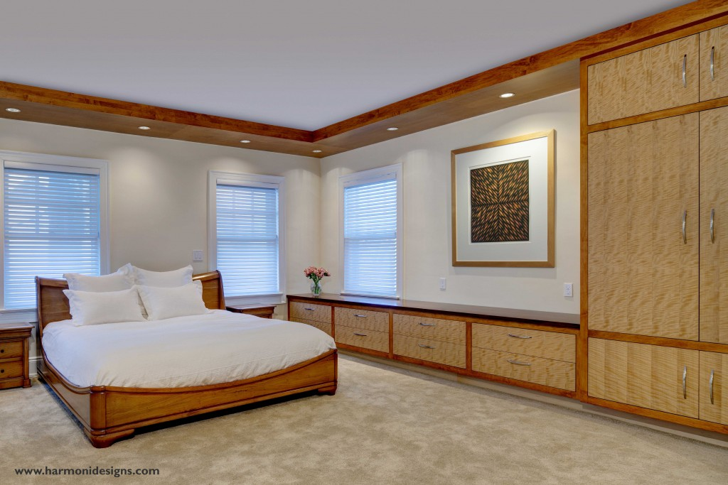 Remodeled master bedroom with warm natural wood cabinetry and a beautiful sleigh bed