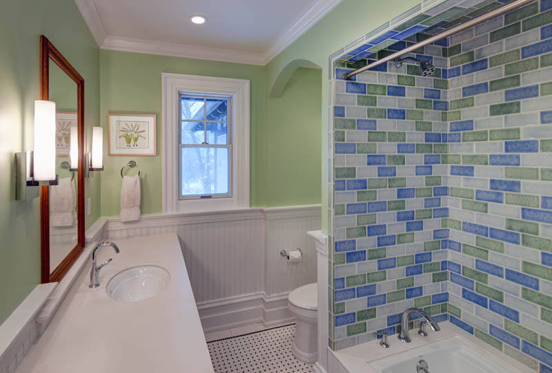 Children's bathroom with blue and green glazed tile