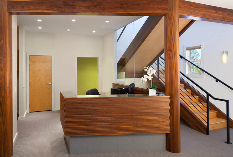 Walnut reception desk beams and columns