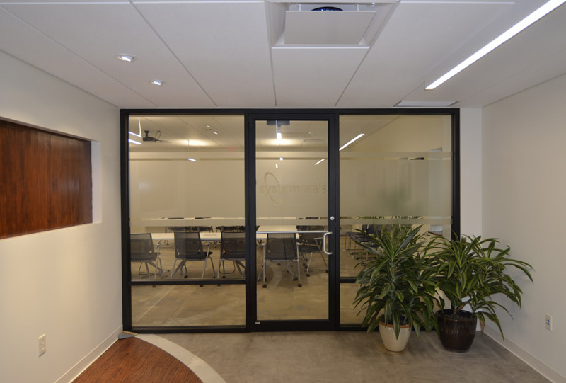 Contemporary office interior glass wall