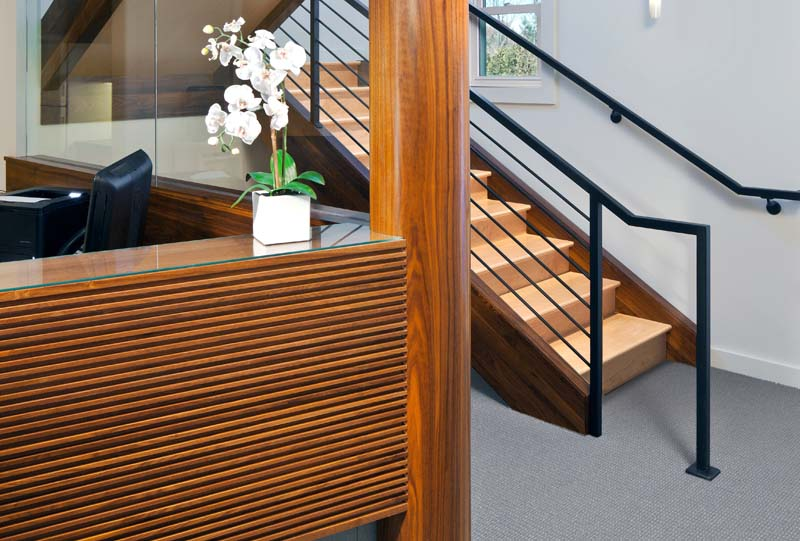 Walnut wood detail at contemporary reception desk