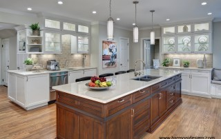 traditional white kitchen with dark wood island