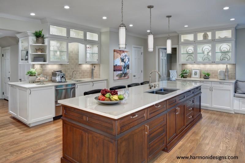 traditional white kitchen with dark wood island