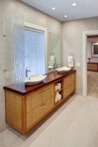 Modern custom vanity with bird's eye maple