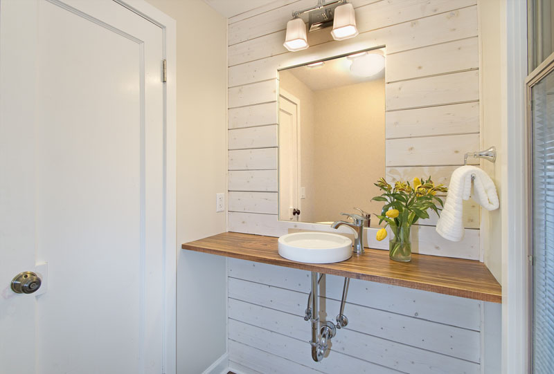 Powder room with white shiplap